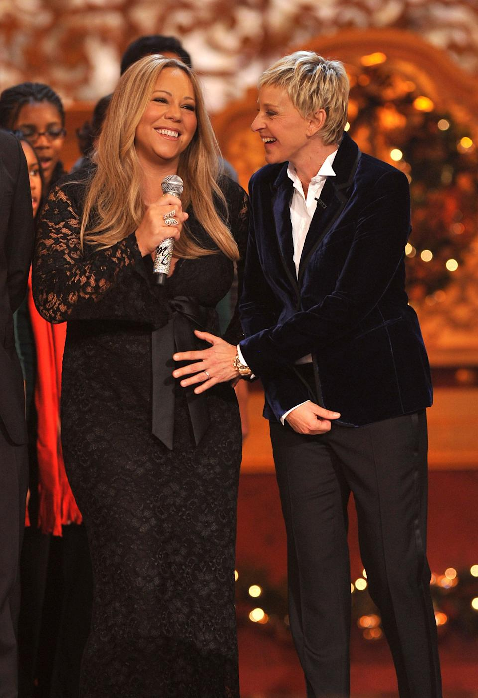 Carey, pregnant with twins at the time, and Ellen DeGeneres perform together during a Christmas event in 2010. (Photo: Theo Wargo via Getty Images)