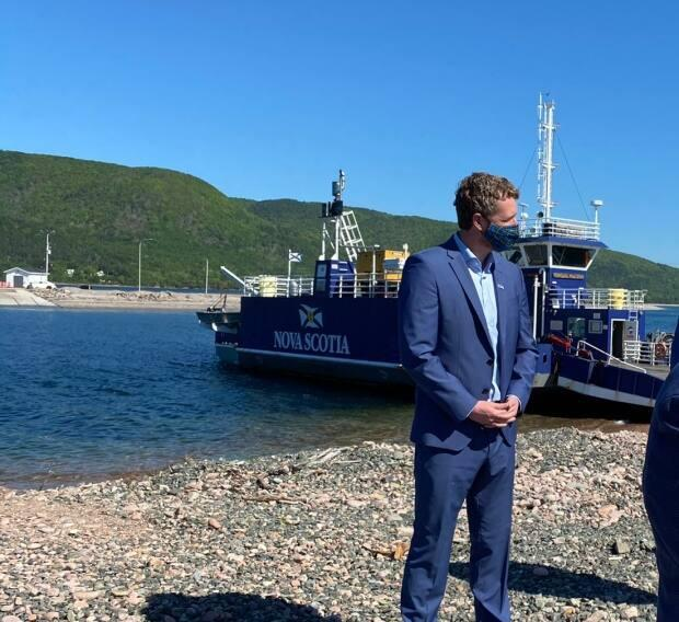 Premier Iain Rankin made the announcement at the Englishtown ferry terminal in Victoria County on Saturday. (Matthew Moore/CBC - image credit)