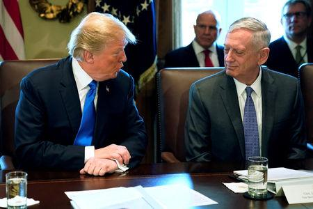 FILE PHOTO: U.S. President Donald Trump, flanked by Defense SecretaryJames Mattis (R), speaks to reporters before he holds a cabinet meeting at the White House in Washington, U.S. December 6, 2017.  REUTERS/Jonathan Ernst/File Photo