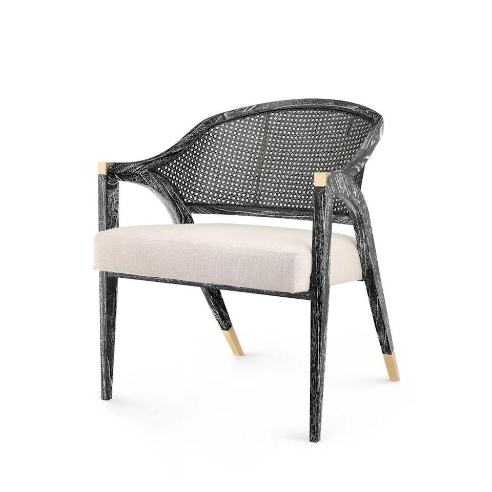 "<p><strong>Bungalow 5</strong></p><p>claytongrayhome.com</p><p><strong>$1067.00</strong></p><p><a href=""https://claytongrayhome.com/collections/all/products/bungalow-5-edward-chair-black"" rel=""nofollow noopener"" target=""_blank"" data-ylk=""slk:Shop Now"" class=""link rapid-noclick-resp"">Shop Now</a></p><p>The stunning black limed finish on Bungalow 5's Edward lounge chair takes natural, hand-tied cane to new heights. </p>"