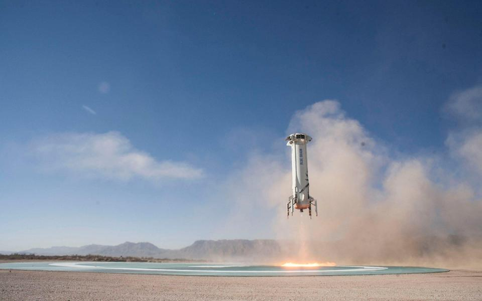 A New Shepard booster landing on a pad in West Texas during development - Blue Origin/Mega