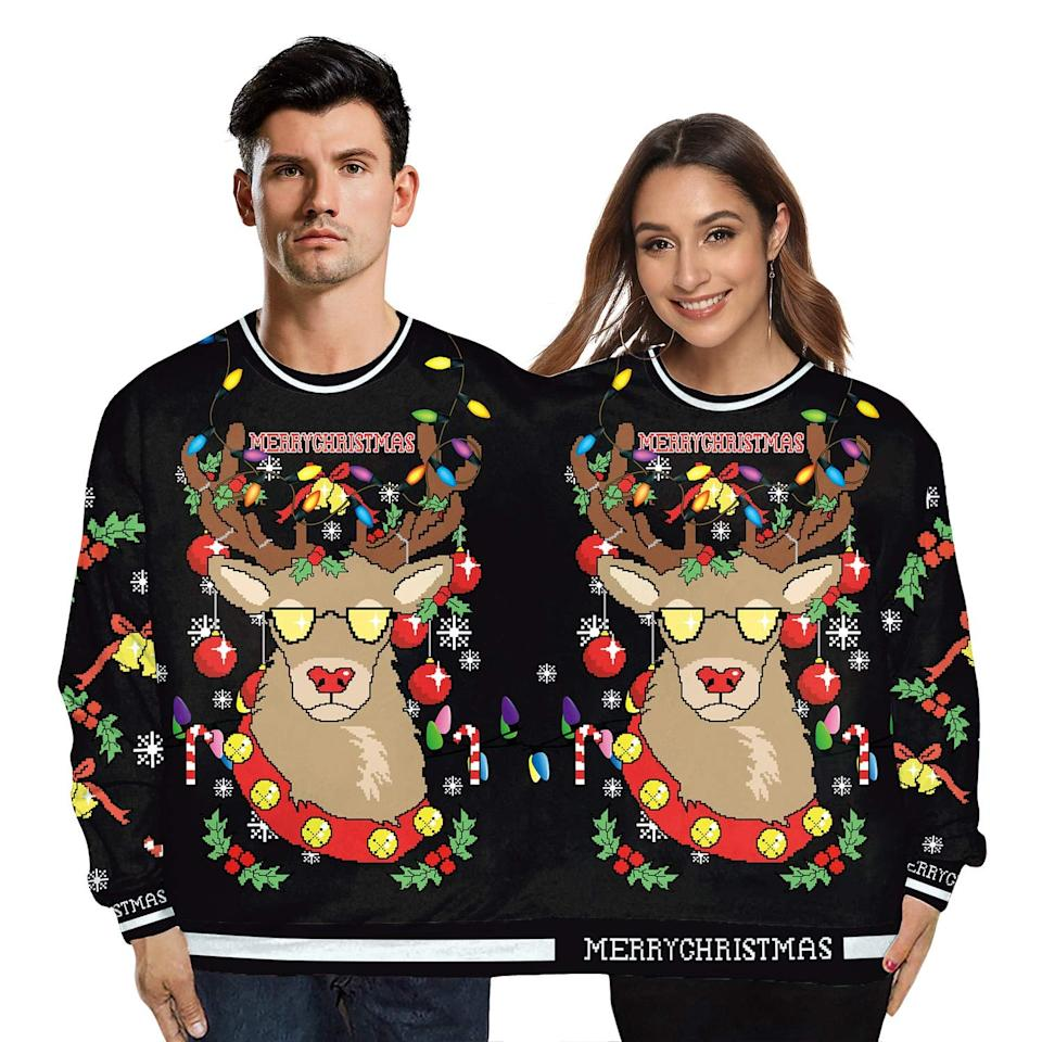 """<p>This <a href=""""https://www.popsugar.com/buy/Two-Person-Pullover-Reindeer-Sweatshirt-520448?p_name=Two-Person%20Pullover%20Reindeer%20Sweatshirt&retailer=amazon.com&pid=520448&price=27&evar1=tres%3Auk&evar9=45531367&evar98=https%3A%2F%2Fwww.popsugar.com%2Flove%2Fphoto-gallery%2F45531367%2Fimage%2F45531690%2FTwo-Person-Ugly-Reindeer-Sweater&list1=shopping%2Csweaters%2Choliday%2Chumor%2Ccouples%2Cchristmas%2Cwinter%2Crelationships%2Cugly%20sweater&prop13=api&pdata=1"""" rel=""""nofollow"""" data-shoppable-link=""""1"""" target=""""_blank"""" class=""""ga-track"""" data-ga-category=""""Related"""" data-ga-label=""""https://www.amazon.com/color-cosplayer-Christmas-Pullover-Conjoined/dp/B07YBZVK3R/ref=sr_1_18_sspa?crid=K9P3LTRGQ5HY&amp;keywords=couples+ugly+christmas+sweater&amp;qid=1574200675&amp;sprefix=couples+ugly+chrst%2Caps%2C206&amp;sr=8-18-spons&amp;psc=1&amp;spLa=ZW5jcnlwdGVkUXVhbGlmaWVyPUEyTThPRzkxRkxQNzNEJmVuY3J5cHRlZElkPUEwOTE2NTM1M0k0TE1QRlFXSkdTQSZlbmNyeXB0ZWRBZElkPUEwMzY4OTA2MzJZNDFEMTdMRFBCTyZ3aWRnZXROYW1lPXNwX210ZiZhY3Rpb249Y2xpY2tSZWRpcmVjdCZkb05vdExvZ0NsaWNrPXRydWU="""" data-ga-action=""""In-Line Links"""">Two-Person Pullover Reindeer Sweatshirt</a> ($27) is equally funny and festive.</p>"""