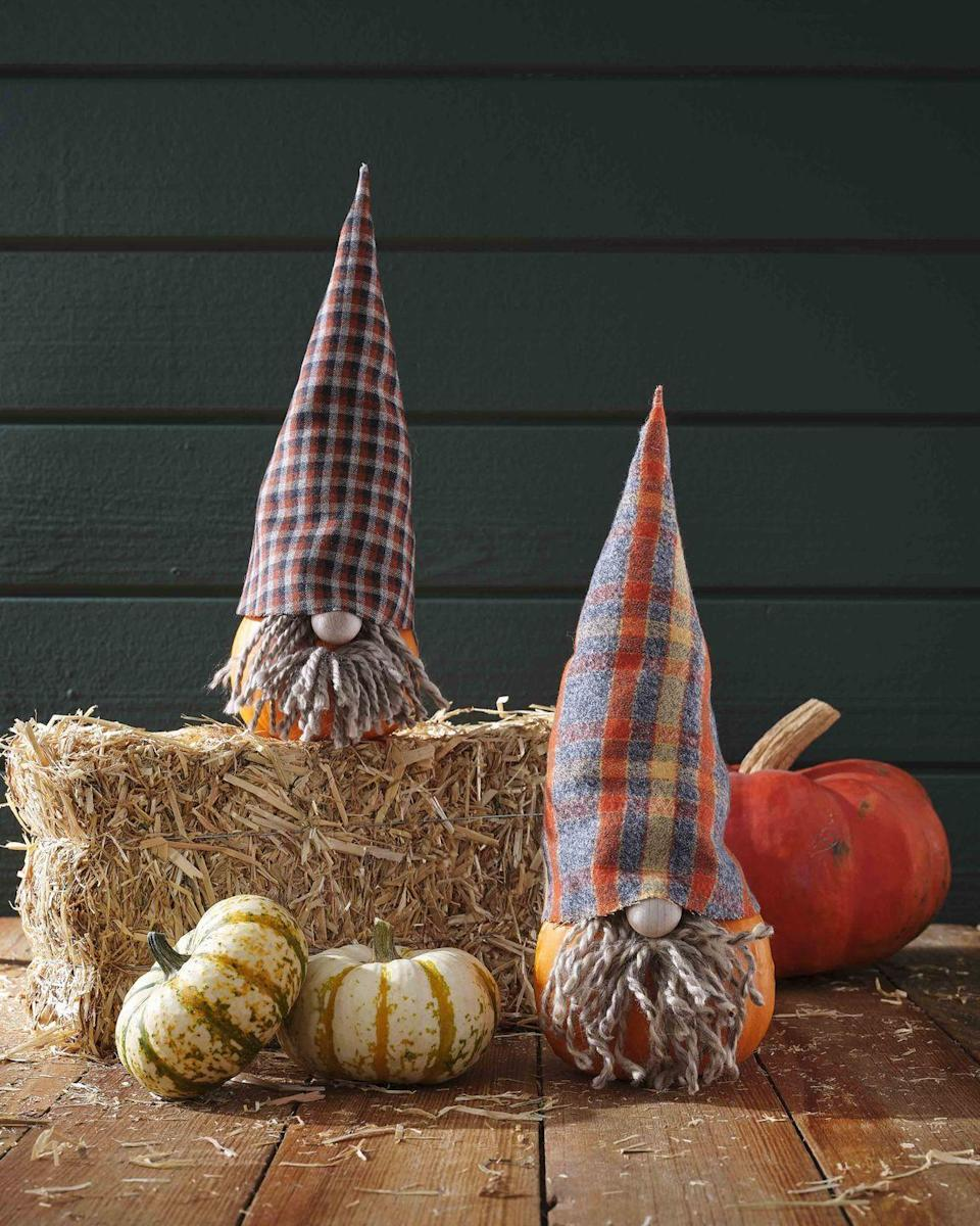 """<p>Welcome visitors with these sweet petite gnome friends.<strong><br></strong></p><p><strong>Make the pumpkin:</strong> Trace hat <a href=""""https://hmg-prod.s3.amazonaws.com/files/gnomehat-1592336643.pdf?tag=syn-yahoo-20&ascsubtag=%5Bartid%7C10050.g.1533%5Bsrc%7Cyahoo-us"""" rel=""""nofollow noopener"""" target=""""_blank"""" data-ylk=""""slk:template"""" class=""""link rapid-noclick-resp"""">template</a> on wool fabric, adjusting size as necessary; cut out. Use craft glue or iron-on fusible tape to glue straight edges together. Fill hat with batting to help it stand upright; set on pumpkin. Attach a small wood craft bead to a small pumpkin with hot-glue to create a nose. Attach strands of yarn with hot glue around nose to create beard; trim as necessary. </p>"""