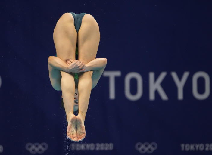 Anabelle Smith of Australia competes in women's diving 3m springboard preliminary at the Tokyo Aquatics Centre at the 2020 Summer Olympics, Friday, July 30, 2021, in Tokyo, Japan. (AP Photo/Dmitri Lovetsky)