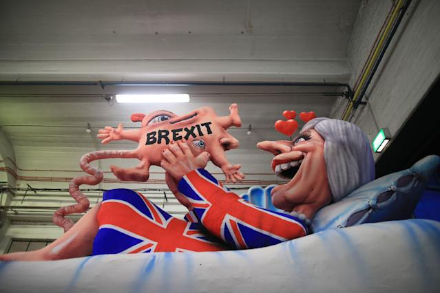 <p>A carnival float, depicting Britain's Prime Minister Theresa May giving birth to the Brexit, is being prepared at a warehouse ahead of a carnival parade on Rose Monday on Feb. 12, 2018 in Duesseldorf, southern Germany. (Photo: Marcel Kusch/Getty Images) </p>