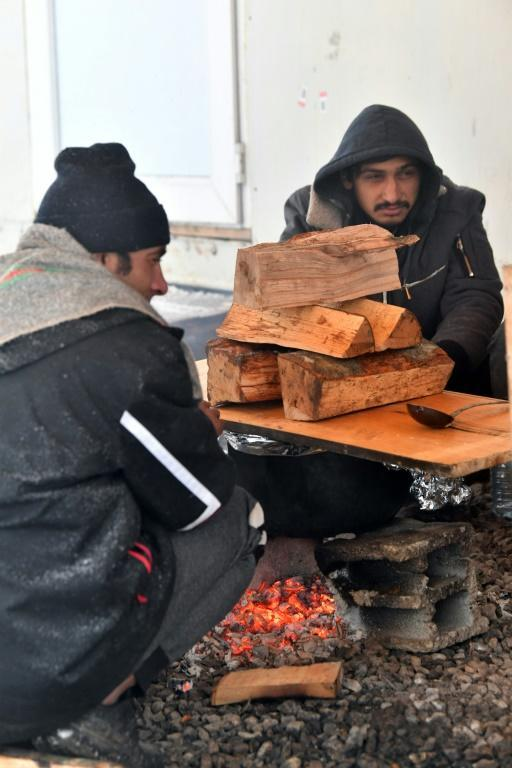 Red Cross volunteers have been providing some food to the migrants who have been sleeping rough in a nearby forest