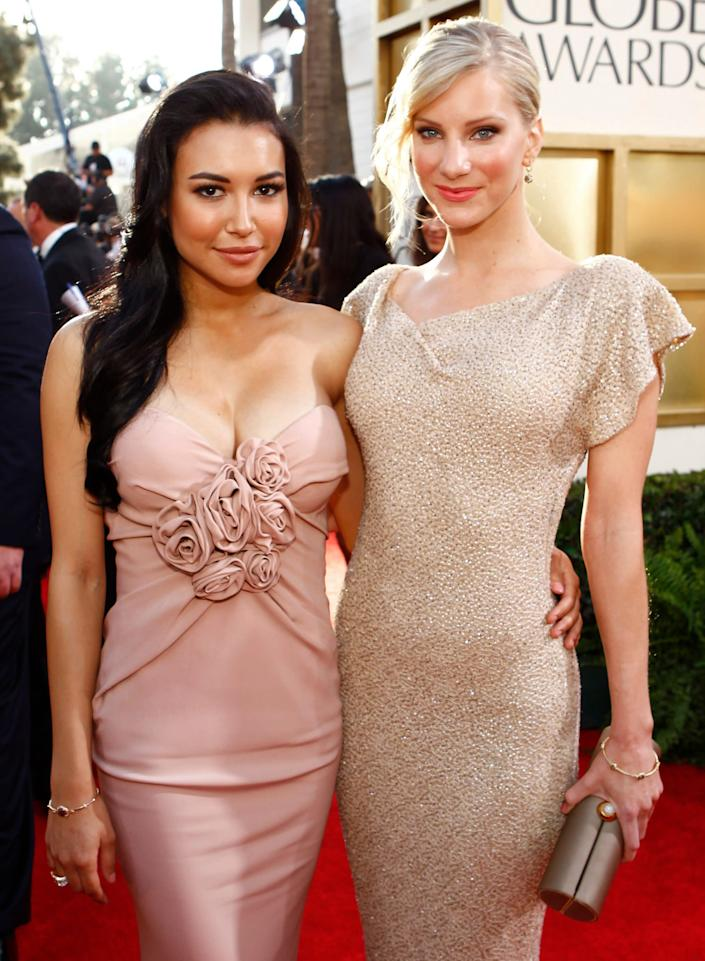 Naya Rivera (left) and Heather Morris arrive at the 68th Annual Golden Globe Awards in 2011. (Photo: NBC via Getty Images)