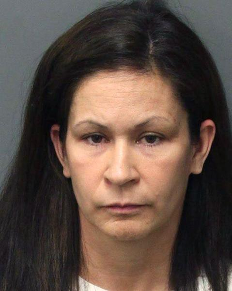 This photo released by the Riverside Police Dept. shows Andrea Michelle Cardosa, 40, who was arrested on Monday, Feb. 3, 2014 in Perris, Calif. Cardosa a former Southern California educator was jailed on felony charges that could send her to prison for life after a former female student accused her of sexual abuse in a YouTube video that's gained nearly a million views and prompted another girl to come forward. (AP Photo/Riverside Police Dept.)
