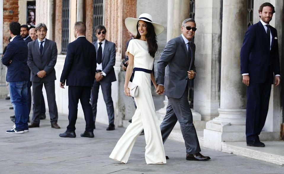 <p>Amal and George Clooney's wedding weekend in Venice included a mirage of gorgeous gowns worn by the lawyer. Our favorite? The chic white jumpsuit and wide brimmed hat she reportedly wore for their civil ceremony. </p>