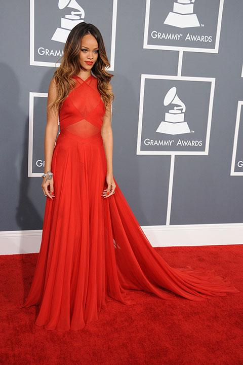 Rihanna covered herself in all the right places this time around with a red Azzedine Alaia gown; and with a train for additional drama. The result: pure class.
