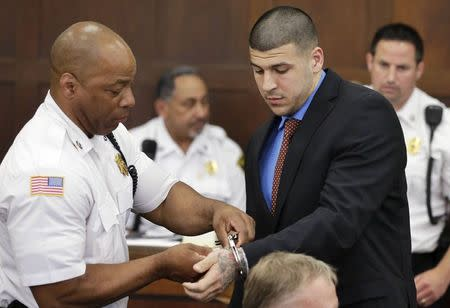 A court officer removes handcuffs from former New England Patriots football player Aaron?Hernandez during a hearing in Suffolk Superior Court in Boston