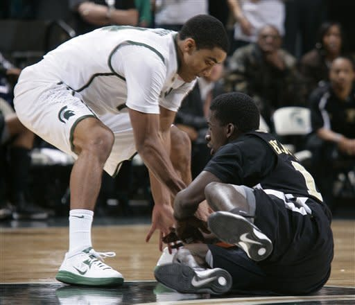 Michigan State's Gary Harris, left, and Arkansas-Pine Bluff's Tevin Hammond wrestle for the ball during the first half of an NCAA college basketball game on Wednesday, Dec. 5, 2012, in East Lansing, Mich. (AP Photo/Al Goldis)