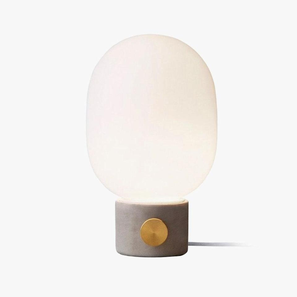 "I adore both the look and functionality of my JWDA table lamps, designed by Jonas Wagel for Menu. The minimalist concrete base is warmed up by the brass knob, which also acts as a dimmer. No matter the time of day, these lamps ensure just the right amount of atmospheric light. $260, AMAZON. <a href=""https://www.amazon.com/Menu-JWDA-Concrete-Table-Lamp/dp/B00O7XGC6C/ref=sxts_sxwds-bia-wc-drs-ajax1_0?cv_ct_cx=Menu&dchild=1&keywords=Menu&pd_rd_i=B00O7XGC6C&pd_rd_r=9f95b674-4629-4a32-ade5-f30b35d459a0&pd_rd_w=5NjoR&pd_rd_wg=JWXE2&pf_rd_p=037ca9fd-790e-4a16-836b-14da89aed20e&pf_rd_r=Y4J2EV6R359AT56AYATG&psc=1&qid=1601917593&sr=1-1-25b07e09-600a-4f0d-816e-b06387f8bcf1"" rel=""nofollow noopener"" target=""_blank"" data-ylk=""slk:Get it now!"" class=""link rapid-noclick-resp"">Get it now!</a>"