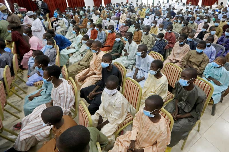 Rescued Nigerian school boys sit together at the Government house in Katsina