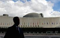 A man walks past the United Nations Headquarters during the 76th Session of the UN General Assembly (AFP/Angela Weiss)