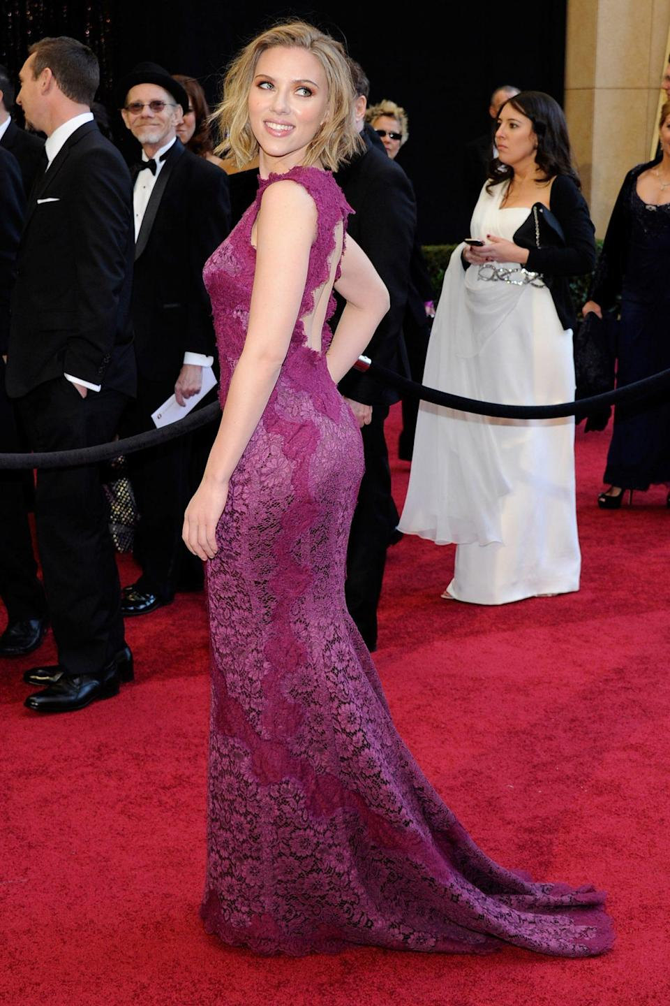 <p>Scarlett Johansson wore a magenta Dolce & Gabbana number with an open back and lots of lace. </p>
