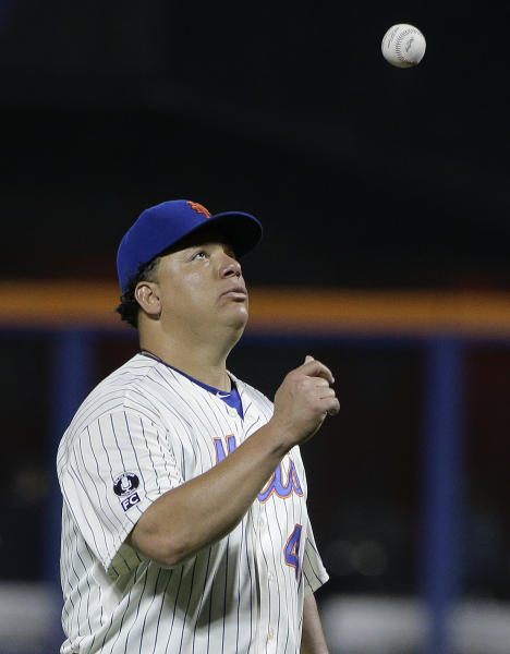 New York Mets pitcher Bartolo Colon (40) tosses the ball up between batters in the sixth inning of a baseball game against the Atlanta Braves, Thursday, July 10, 2014, in New York. (AP Photo/Julie Jacobson)