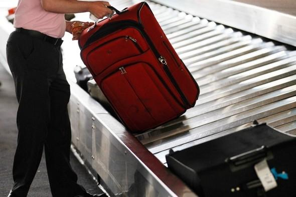 Gay couple sue airline after 'sex toy strapped to bag'