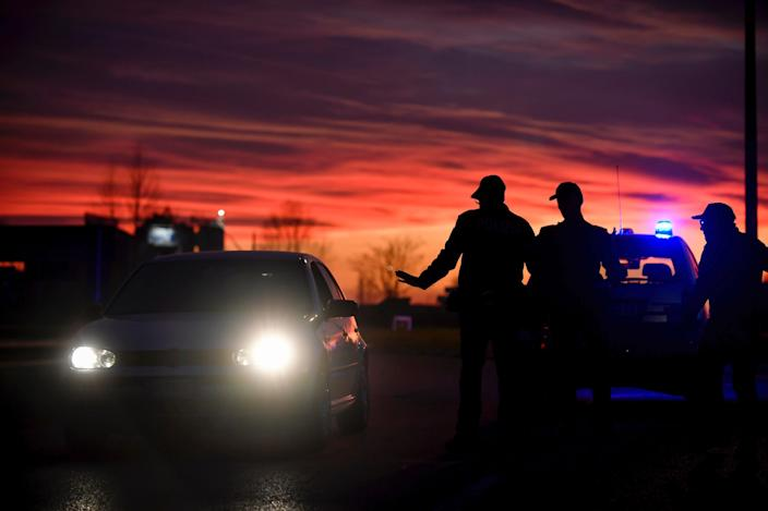 Police stops cars trying to enter or leave the cordoned area in Casalpusterlengo, Northern Italy, Sunday, Feb. 23, 2020.