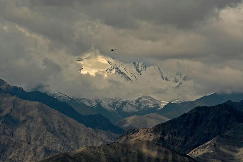 Indian fighter jets roared over a flashpoint Himalayan region on June 24 as part of a show of strength following what military sources say has been a Chinese takeover of contested territory.