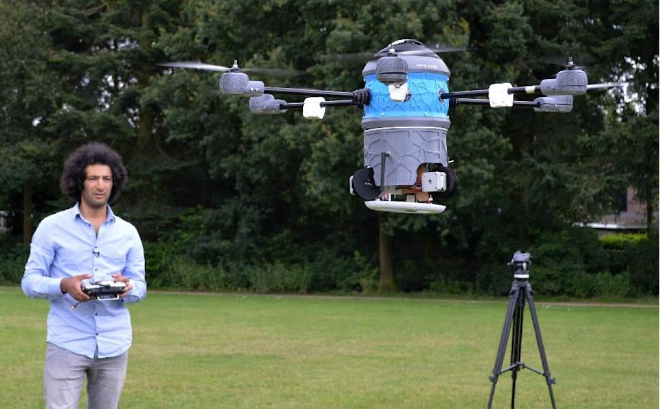 Massoud and Mahmud Hassani's latest mine-hunting device combines drone technology, 3D printing and robotics with a metal detector to find and ultimately destroy landmines (AFP Photo/Jan Hennop)