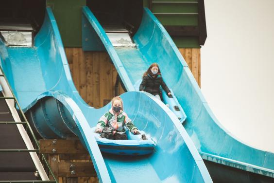 Slide fun at the newly opened park (Colin Drury/The Independent)