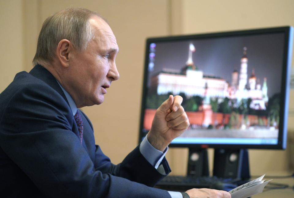 Russian President Vladimir Putin speaks during a meeting with government officials via video conference at the Novo-Ogaryovo residence outside Moscow, Russia, Monday, March 22, 2021. Putin said he will get vaccinated against the coronavirus on Tuesday, March 23, 2021, months after widespread vaccination has started in Russia. (Alexei Druzhinin, Sputnik, Kremlin Pool Photo via AP)