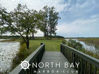 Residents at North Bay Harbor Club enjoy beautiful natural amenities including lake access and this private island.