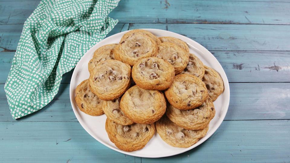 """<p><a href=""""https://www.delish.com/restaurants/g3603/best-chocolate-chip-cookies/"""" rel=""""nofollow noopener"""" target=""""_blank"""" data-ylk=""""slk:Chocolate chip cookies"""" class=""""link rapid-noclick-resp"""">Chocolate chip cookies</a>, the across-the-board favorite in any cookie poll, were <a href=""""https://www.delish.com/food-news/a49236/toll-house-cookie-dough-fun-facts/"""" rel=""""nofollow noopener"""" target=""""_blank"""" data-ylk=""""slk:invented in Massachusetts"""" class=""""link rapid-noclick-resp"""">invented in Massachusetts</a> in 1938, which explains why it's still the official state cookie. It's hard to beat the combination of melty, semi-sweet morsels in a soft-centered, sugary dough.</p><p>Get the recipe from <a href=""""https://www.delish.com/cooking/recipes/a53304/duff-goldman-chocolate-chip-cookies-recipe/"""" rel=""""nofollow noopener"""" target=""""_blank"""" data-ylk=""""slk:Delish"""" class=""""link rapid-noclick-resp"""">Delish</a>.</p>"""