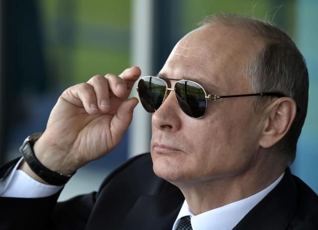 Russian President Vladimir Putin watches an aerobatics team performance at the opening ceremony of the MAKS-2017 in Zhukovsky, outside Moscow, Russia, July 18, 2017. (Alexei Nikolsky, Kremlin Pool Photo via AP)