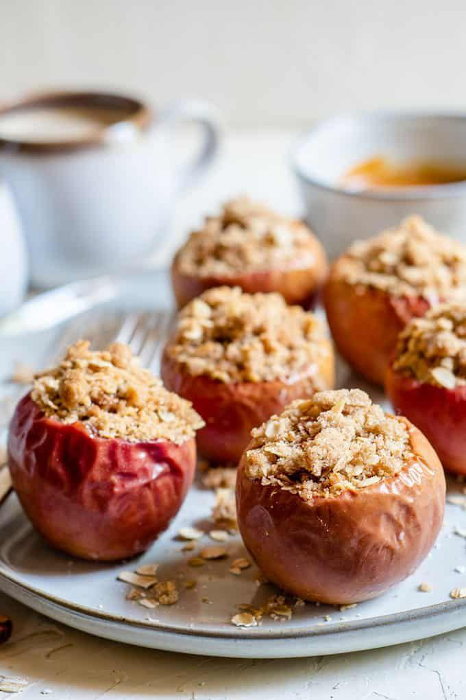"""<p>Here's a simple way to showcase your apple harvest—fill the apples with a brown sugar oatmeal cookie crumble and bake until soft and tender. </p><p><strong>Get the recipe at <a href=""""https://thesaltymarshmallow.com/oatmeal-crumble-baked-apples/"""" rel=""""nofollow noopener"""" target=""""_blank"""" data-ylk=""""slk:The Salty Marshmallow"""" class=""""link rapid-noclick-resp"""">The Salty Marshmallow</a>.</strong></p>"""