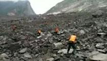Around 100 people feared buried in China landslide