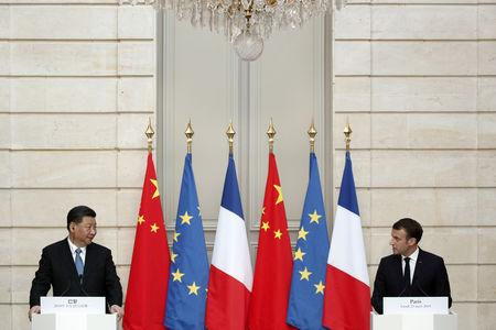 French President Emmanuel Macron and Chinese President Xi Jinping hold a news conference after a meeting at the Elysee Palace in Paris