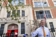 FILE — In this Aug. 19, 2020 file photo, New York Mayor Bill de Blasio speaks to reporters after visiting New Bridges Elementary School to observe pandemic-related safety procedures, in the Brooklyn borough of New York. New York City is delaying the start of its school year by several days to give teachers more time to prepare to have students back in classrooms amid the coronavirus pandemic, Mayor Bill de Blasio announced Tuesday, Sept. 1. (AP Photo/John Minchillo, FIle)