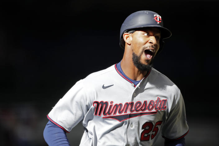 Minnesota Twins' Byron Buxton reacts after hitting a two-run home run during the seventh inning of an opening day baseball game against the Milwaukee Brewers, Thursday, April 1, 2021, in Milwaukee. (AP Photo/Aaron Gash)