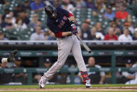 Boston Red Sox's J.D. Martinez hits a one-run single against the Detroit Tigers in the first inning of a baseball game in Detroit, Tuesday, Aug. 3, 2021. (AP Photo/Paul Sancya)