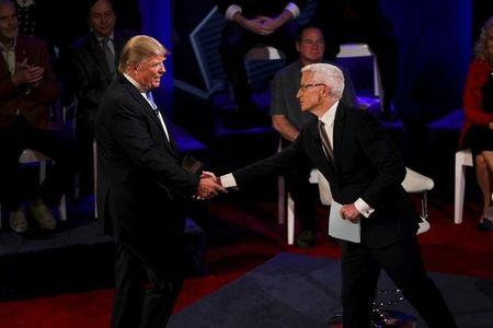 Republican U.S. Presidential candidate Donald Trump shakes hands with CNN anchor Anderson Cooper at the CNN Town Hall at Riverside Theater in Milwaukee