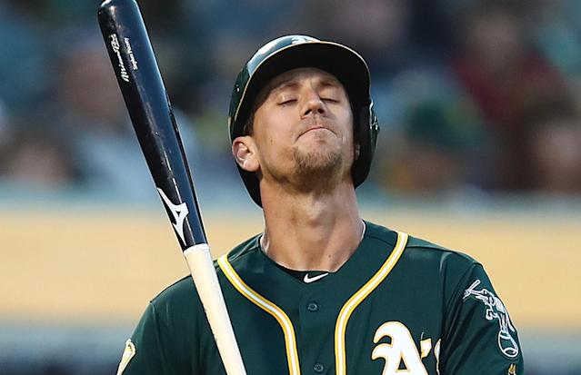 Stephen Piscotty took an emotional moment with the Oakland A's crowd in his first game since his mother's death, then hit a line drive up the middle. (AP)