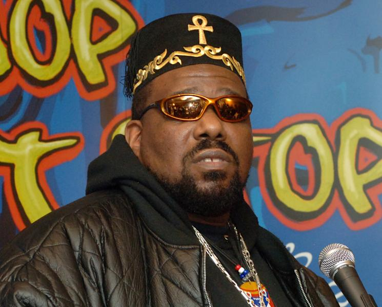 "FILE - This Feb. 28, 2006 file photo shows hip hop DJ pioneer Afrika Bambaataa speaking at a news conference to launch ""Hip-Hop Won't Stop: The Beat, The Rhymes, The Life,"" the first ever hip-hop initiative at the Smithsonian's National Museum of American History in New York. Bambaataa has been appointed to a three-year term as a visiting scholar at Cornell University. The appointment announced Tuesday, Aug. 14, 2012, was made by Cornell University Library's Hip Hop Collection in conjunction with the Ivy League school's music department. (AP Photo/Henny Ray Abrams, file)"
