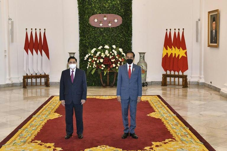 Indonesian President Joko Widodo (right) and Vietnam's Prime Minister Pham Minh Chinh at the Presidential Palace in Jakarta ahead of the summit