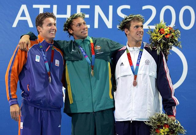 Bronze medalist Michael Phelps, right, of the U.S., gold medalist Ian Thorpe of Australia, center, and silver medalist Pieter van den Hoogenband of the Netherlands pose with their medals after the 200m freestyle the 2004 Olympic Games Monday, August 16 2004 in Athens, Greece. (AP Photo/Mark Baker)