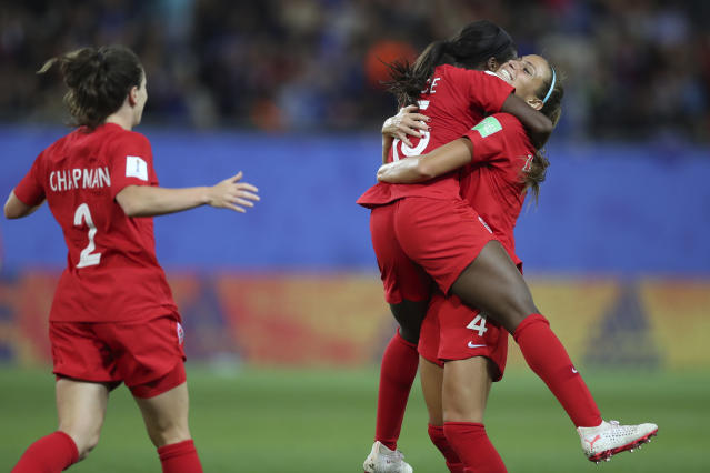 Nichelle Prince, center, celebrates with teammates after scoring for Canada against New Zealand. (Getty)