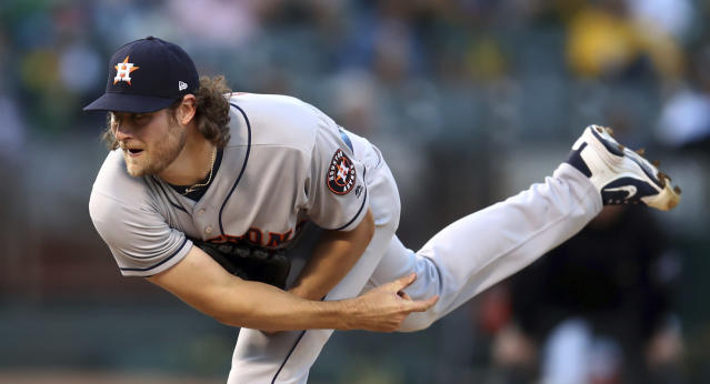 Houston Astros pitcher Gerrit Cole follows through on a delivery to an Oakland Athletics batter during the first inning of a baseball game Wednesday, June 13, 2018, in Oakland, Calif. (AP Photo/Ben Margot)