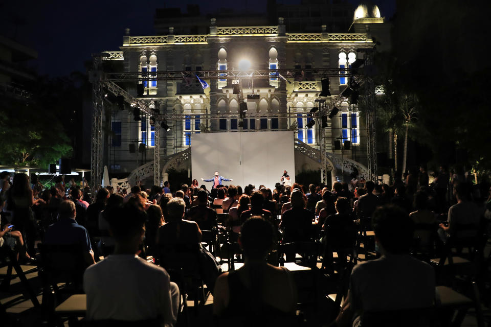 An audience attends a performance in the courtyard of the Sursock Museum, which was damaged in the explosion last August at Beirut's port, in Beirut, Lebanon, Thursday, July 8, 2021. Lebanon's only modern art museum, the Sursock, is still rebuilding a year after the explosion decimated it and some hope that reopening it will be a first step in the harder task of rebuilding the city's once thriving arts scene. (AP Photo/Hussein Malla)