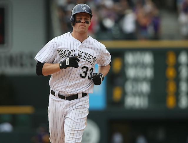 Colorado Rockies' Justin Morneau circles the bases after hitting a two-run, walkoff home run against the San Diego Padres in the 10th inning of the Rockies' 8-6 victory in 10 innings of a baseball game in Denver on Sunday, May 18, 2014. (AP Photo/David Zalubowski)