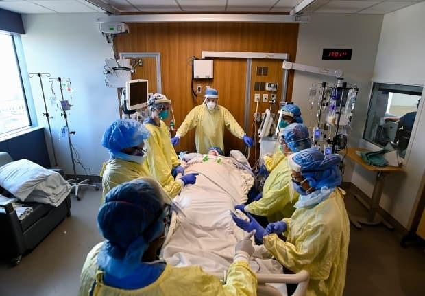 In this file photo, doctors in Ontario surround a COVID-19 patient who is in the ICU. The SHA has not allowed media access inside Saskatchewan ICUs.