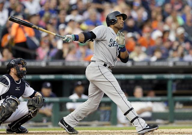Seattle Mariners' Robinson Cano connects for a solo home run to right field off Detroit Tigers starting pitcher Rick Porcello during the third inning of a baseball game, Friday, Aug. 15, 2014, in Detroit. (AP Photo/Carlos Osorio)