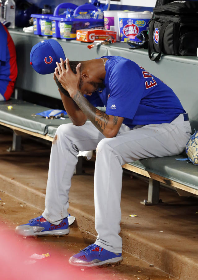 Chicago Cubs relief pitcher Carl Edwards Jr. sits on the bench after being replaced in the eighth inning of the team's baseball game against the Atlanta Braves on Wednesday, May 16, 2018, in Atlanta. The Braves won 4-1. (AP Photo/John Bazemore)