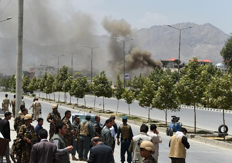 Black smoke billows from the Afghan parliament building in Kabul on June 22, 2015, during an attack in the Afghan capital (AFP Photo/Shah Marai)