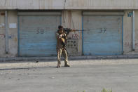 An Afghan security personnel take a position during fighting between Taliban and Afghan security forces in Herat province, west of Kabul, Afghanistan, Tuesday, Aug. 3, 2021. (AP Photo/Hamed Sarfarazi)